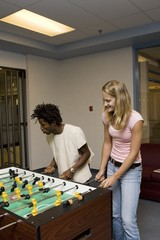 Teenagers Playing Foosball