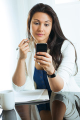 Businesswoman consulting their mobile phone