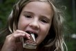 Girl Eating Ice Cream Bar, Lake Of The Woods, Ontario, Canada