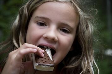 Girl Eating Ice Cream Bar, Lake Of The Woods, Ontario, Canada