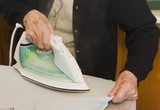 Housework; Older Woman Ironing
