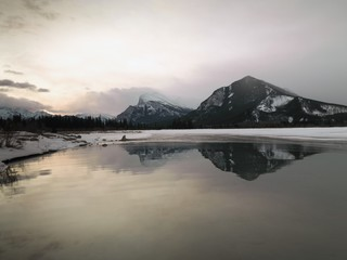 Mountains Reflecting In Water; Banff, Alberta, Canada