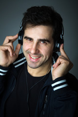Handsome young man listening the music in headphones