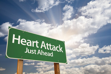 Heart Attack Green Road Sign and Clouds