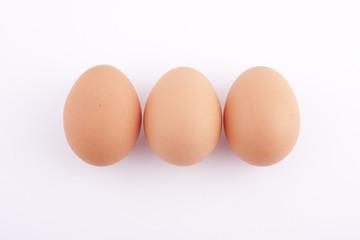 three eggs on the white