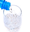 bottle pouring water into  glass