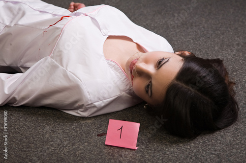 Nurse lying on the floor
