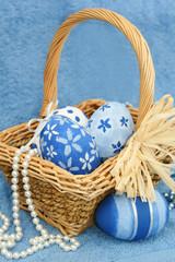 blue eggs in a basket
