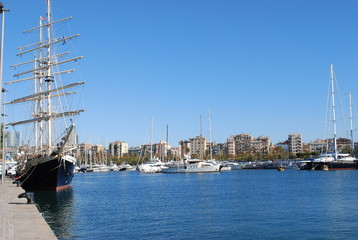 Sailboat and yachts at the marina