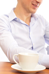 young man with a cup of tea