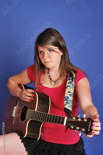 pretty girl playing guitar