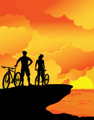 A boy and a girl – sunset landscape.
