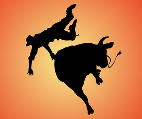 bull riding black silhouette on a sunrise background