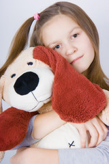 Girl with toy dog