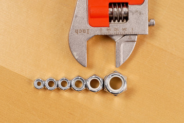 Row of Hex Bolt Fasteners with Wrench