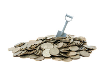 Shovel standing in pile of coins