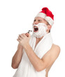 shaving man with foam and razor in red Christmsa hat