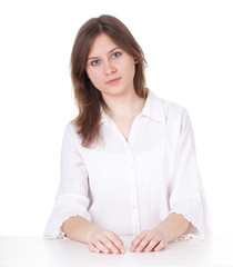 thoughtful young woman in white blouse
