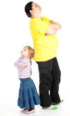 fat mother and preschool daughter having quarrel