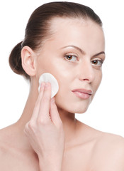 Young beautiful woman with clean sponge