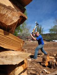 Teenage Boy Chopping Wood