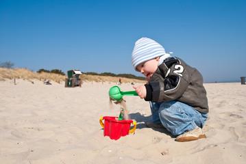 Buddeln am Sandstrand