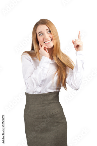 Young happy businesswoman pointing up