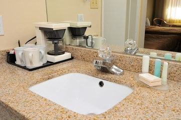 Washing basin with drinking utensils
