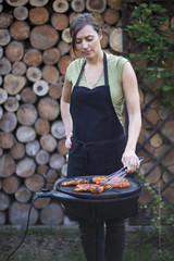Barbecue woman checking the meat