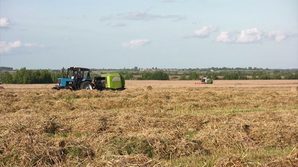 Tractor working on wheat field
