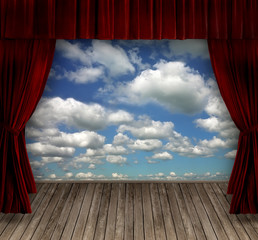 Red velvet curtains and sky background