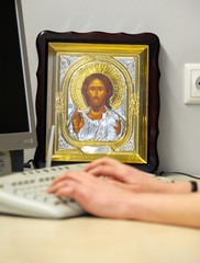 Religious icons in a modern office