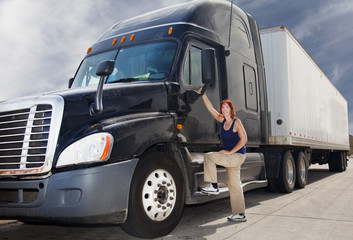 Woman driver with her commercial 18-wheeler   deisel semi truck.