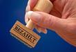 Bezahlt - Stempel mit Hand