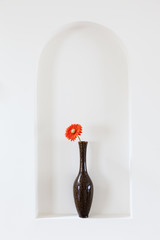 Vase with red flower
