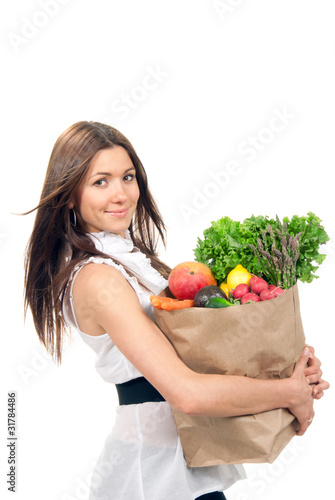 woman holding a shopping bag full of groceries