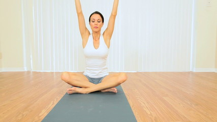 Brunette Female Practicing Yoga