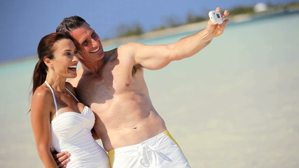 Couple with Camera on Beach Vacation