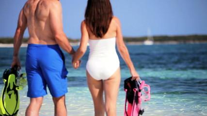 Slim Couple in Ocean Ready for Snorkeling
