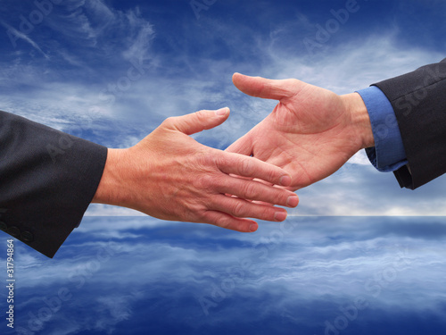 Two businessmen reaching for handshake
