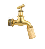 Old gold faucet closed with cork isolated on white