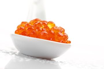 Salmon caviar in spoon