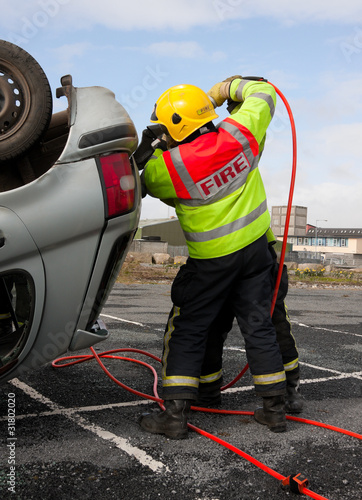 Fireman with Power Wedge at car crash resque