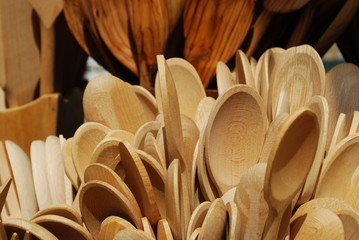 Group of wooden cooking spoons on sale at market