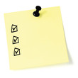 Yellow sticker checklist black check boxes tick marks thumbtack