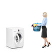 Woman with a laundry basket going towards a washing machine