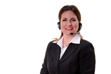 Relaxed business woman wearing headset
