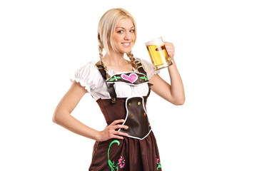 Woman wearing a traditional costume and holding a beer