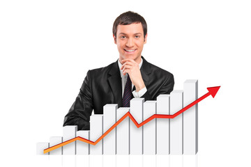 Smiling businessman behind a 3d rendered financial graph