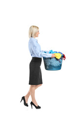 Full length portrait of a young woman carrying a laundry basket